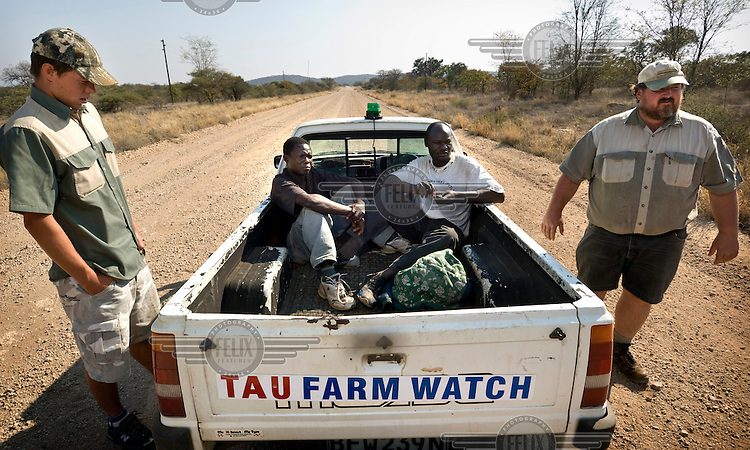 """White farmers arresting Zimbabwean immigrants who have attempted to cross the South African-Zimbabwean border illegally after cutting holes in the border fence. The men, known as """"border jumpers"""", have been apprehended by the farm owners patrolling their farmland near the border crossing at Musina near Beitbridge. The arrested migrants will be handed over to the police, who will then extradite them to Zimbabwe. However, many of the border jumpers will again attempt to cross the border within only a few hours of their first arrest."""