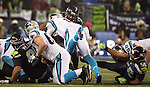 Carolina Panthers quarterback Kam Newton (1) dives over the Seattle Seahawks  defensive front for a first down during the NFC Western Division Playoffs at CenturyLink Field  on January 10, 2015 in Seattle, Washington. The Seahawks beat the Panthers 31-17. ©2015. Jim Bryant Photo. All Rights Reserved.