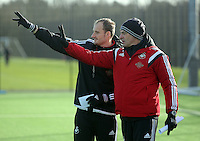 SWANSEA, WALES - JANUARY 28: (L-R) Dave Adams and Diego Bortoluzzi set up training during the Swansea City Training Session on January 28, 2016 in Swansea, Wales.