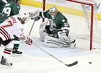 Bemidji State goalie Dan Bakala watches as UNO's Matt Ambroz  closes in on the puck as time expires in overtime. UNO and Bemidji State skated to a 2-2 tie Friday night at Qwest Center Omaha. (Photo by Michelle Bishop)