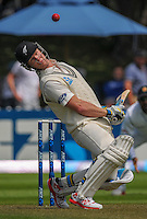 Jimmy Neesham dodges a bouncer during day one of the 2nd cricket test match between the New Zealand Black Caps and Sri Lanka at the Hawkins Basin Reserve, Wellington, New Zealand on Saturday, 3 February 2015. Photo: Dave Lintott / lintottphoto.co.nz