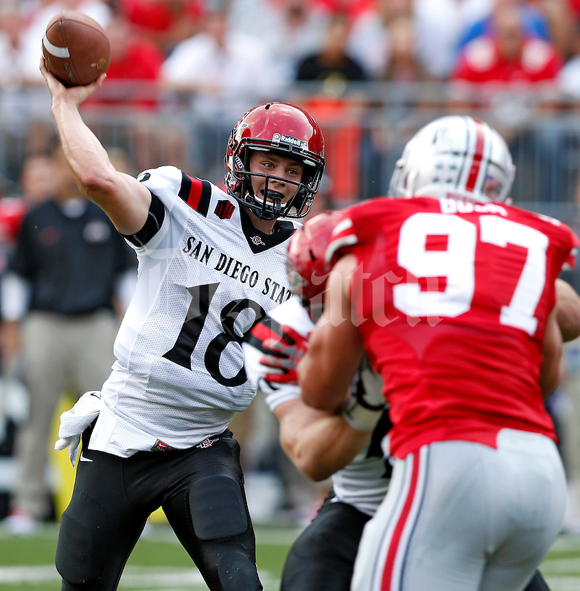 San Diego State Aztecs quarterback Quinn Kaehler (18) throws to a receiver against Ohio State Buckeyes during the 2nd quarter of their college football game at Ohio Stadium in Columbus on September 7, 2013.  (Dispatch photo by Kyle Robertson)
