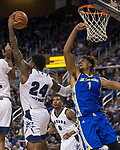 Nevada forward Jordan Caroline (24) grabs a rebound away from San Jose State forward Michael Steadman (1) in the second half of an NCAA college basketball game in Reno, Nev., Wednesday, Jan. 9, 2019. (AP Photo/Tom R. Smedes)