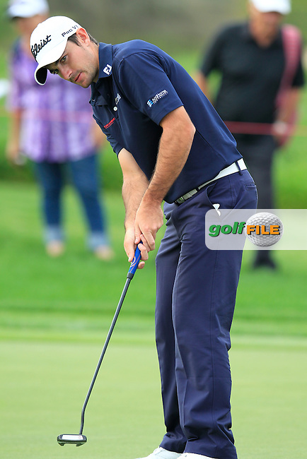 Gary Stal (FRA) takes his putt on the 13th green during Sunday's Final Round of the Abu Dhabi HSBC Golf Championship 2015 held at the Abu Dhabi Golf Course, United Arab Emirates. 18th January 2015.<br /> Picture: Eoin Clarke www.golffile.ie
