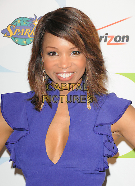 ELISE NEAL .at the Jenesse 30th Anniversary Silver Rose Gala & Auction held at The Beverly Hills Hotel in Beverly Hills, California, USA, April 18th 2010.                                                                   .portrait headshot  smiling  blue cleavage ruffle ruffles sleeve low cut purple .CAP/RKE/DVS.©DVS/RockinExposures/Capital Pictures.