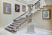 The staircase is a Victorian addition to the Georgian house which Gillette had painted to fit in with the design scheme
