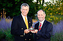 WOBURN, ENGLAND - AUGUST 30:  Gary Wolstenholme of England receives the Rookie of the Year Award from Andy Stubbs, Managing Director of the European Senior Tour at the annual awards dinner held at Woburn Abbey prior to the Travis Perkins plc Senior Masters played at the Duke's course, Woburn Golf Club on August 30, 2012 in Woburn, United Kingdom.  (Photo by Phil Inglis/Getty Images) *** Local Caption *** Gary Wolstenholme; Andy Stubbs