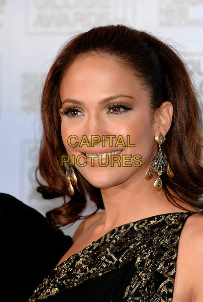 JENNIFER LOPEZ.Pressroom - 64th Annual Golden Globe Awards, Beverly Hills HIlton, Beverly Hills, California, USA. .January 15th 2007.globes headshot portrait dangling gold earrings.CAP/PL.©Phil Loftus/Capital Pictures