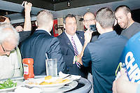 Republican presidential candidate and New Jersey governor Chris Christie greets supporters at Tandy's Top Shelf Pub in Concord, New Hampshire.