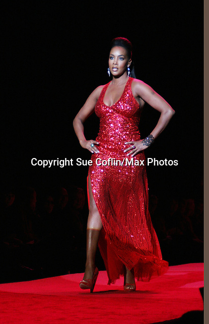 Actress Vivica A. Fox wearing Jenny Packham (Y&R and Days) walks the runway at The Heart Truth's Red Dress Collection 2009 Fashion Show which raises awareness that heart disease is the #1 killer of women was held during Mercedes -Benz Fashion Week New York Fall 09 on February 13, 2009 in Bryant Park, New York City, NY. This event unites with America's top designers to showcase a colleciton of one-of-a-kind Red Dresses. (Photo by Sue Coflin/Max Photos)