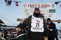 Nathan Schroeder poses for a photo at the finish line in Nome after completing his race on Thursday March 19, 2015 during Iditarod 2015.  <br /> <br /> (C) Jeff Schultz/SchultzPhoto.com - ALL RIGHTS RESERVED<br />  DUPLICATION  PROHIBITED  WITHOUT  PERMISSION