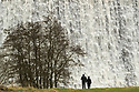 10/02/120<br /> <br /> Dam storm. The morning after the day before. Walkers watch in awe as cascading water thunders over Derwent Reservoir Dam this morning. River levels rose dramatically when Storm Ciara flooded many areas in the Derbyshire Peak District yesterday.<br /> <br /> <br /> All Rights Reserved: F Stop Press Ltd.  <br /> +44 (0)7765 242650 www.fstoppress.com
