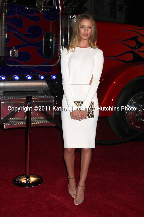 LOS ANGELES - MAY 11:  Rosie Huntington-Whiteley arriving at the Maxim Hot 100 Party at Eden on May 11, 2011 in Los Angeles, CA