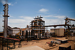 ITUMBIARA, BRAZIL - OCTOBER 16:<br /> Bagasse dust, waste from the sugarcane stalks used to power the Rio Dourado Cargill plant, blankets the plant, near the city of Itumbiara, in Goias state, Brazil, on Wednesday, Oct. 16, 2013. Since the US recently passed a number of regulations and standards for cars and dropped tariffs that were in place for decades against Brazilian sugar, Brazilian ethanol is now flowing to the U.S., and the ethanol industry in the country is consolidating and ramping up for a new era.