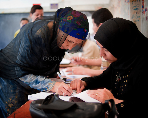 EGYPT - ON THE ROAD TO THE POLLING STATIONS.copyright : Magali Corouge / Documentography.22th of may 2012, Egypt. ..A polling station in Garbage City, Cairo..