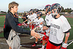 Torrance, CA 05/08/13 - Justin Jones (Palos Verdes #27), Augie O'Hern (Palos Verdes #24), unidentified Palos Verdes player(s) and unidentified Harvard-Westlake player(s) during the coin toss ceremony at the start of the Los Angeles area Lacrosse Championship game.