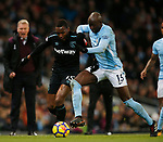 Diafra Sakho of West Ham United tussles with Eliaquim Mangala of Manchester City during the premier league match at the Etihad Stadium, Manchester. Picture date 3rd December 2017. Picture credit should read: Andrew Yates/Sportimage