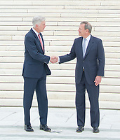 Chief Justice of the United States John G. Roberts, Jr., right, and Associate Justice of the Supreme Court of the United States Neil M. Gorsuch, left, shake hands after posing for photos on the front steps of the US Supreme Court Building after the investiture ceremony for Justice Gorsuch in Washington, DC on Thursday, June 15, 2017. <br /> Credit: Ron Sachs / CNP /MediaPunch