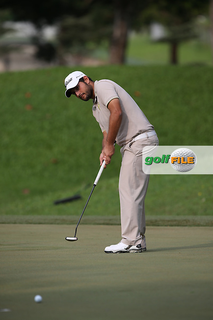 China Open Champion Alexander Levy (FRA) shot a 32 front nine and low score beckoning but for a triple bogey on the 13th ended with a 70 during Round One of the The Championship 2014 from the Laguna National Golf & Country Club, Tampines, Singapore. Picture:  David Lloyd / www.golffile.ie