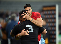 Joe Tuineau of Tonga embraces team-mate Halani Aulika after the match. Rugby World Cup Pool C match between New Zealand and Tonga on October 9, 2015 at St James' Park in Newcastle, England. Photo by: Patrick Khachfe / Onside Images