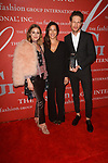 Designers Rebecca Minkoff (center) and Uri Minkoff (right) receive the Technology In Brand Development Award and pose with Olivia Palermo at The Fashion Group International's Night of Stars 2017 gala at Cipriani Wall Street on October 26, 2017.