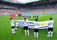 July 26, 2012..Members of URU team sing National Anthem of before the start of 2012 London Olympics group A Football match between United Arab Emirates and Uruguay at Old Trafford in Manchester, England. Uruguay defeat United Arab Emirates 2-1..