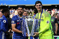Chelsea's Diego Costa and Thibaut Courtois celebrate winning the Premier League Trophy during Chelsea vs Sunderland AFC, Premier League Football at Stamford Bridge on 21st May 2017