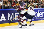 Deutschlands Hordler, Frank (Nr.48) an der Bande im Zweikampf mit Lettlands Blugers, Teodors (Nr.23)  beim Spiel der IIHF 2017 WM, Deutschland - Lettland.<br /> <br /> Foto &copy; PIX-Sportfotos *** Foto ist honorarpflichtig! *** Auf Anfrage in hoeherer Qualitaet/Aufloesung. Belegexemplar erbeten. Veroeffentlichung ausschliesslich fuer journalistisch-publizistische Zwecke. For editorial use only.