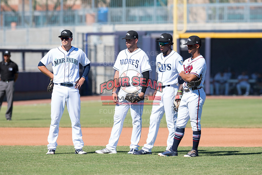 Peoria Javelinas infielders Evan White (15), Hudson Potts (13), Lucius Fox (5), and Ray-Patrick Didder (1) during an Arizona Fall League game against the Scottsdale Scorpions at Peoria Sports Complex on October 18, 2018 in Peoria, Arizona. Scottsdale defeated Peoria 8-0. (Zachary Lucy/Four Seam Images)