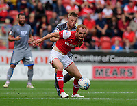 Lincoln City's Joe Morrell vies for possession with Rotherham United's Shaun MacDonald<br /> <br /> Photographer Chris Vaughan/CameraSport<br /> <br /> The EFL Sky Bet Championship - Rotherham United v Lincoln City - Saturday 10th August 2019 - New York Stadium - Rotherham<br /> <br /> World Copyright © 2019 CameraSport. All rights reserved. 43 Linden Ave. Countesthorpe. Leicester. England. LE8 5PG - Tel: +44 (0) 116 277 4147 - admin@camerasport.com - www.camerasport.com