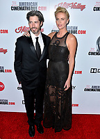 LOS ANGELES, USA. November 09, 2019: Charlize Theron & Jason Reitman at the American Cinematheque Award Gala honoring Charlize Theron at the Beverly Hilton.<br /> Picture: Paul Smith/Featureflash