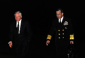 Washington, DC - December 1, 2009 -- United States Secretary of Defense Robert Gates (L) and Chairman of the Joint Chiefs of Staff Admiral Michael Mullen walk across the South Lawn after arriving at the White House with U.S. President Barack Obama (not pictured) in Washington on Tuesday, December 1, 2009. President Obama traveled to West Point Military Academy in New York and spoke on a planned increase of troops and exit strategy for the war in Afghanistan. The buildup is targeted to reverse the Taliban advances in the country and to train Afghan soldiers and police. .Credit: Alexis C. Glenn / Pool via CNP