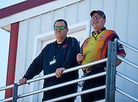 Aug 21, 2016; Brainerd, MN, USA; Elon Werner (left) and Bob Wilber , crew member for NHRA funny car driver Tim Wilkerson during the Lucas Oil Nationals at Brainerd International Raceway. Mandatory Credit: Mark J. Rebilas-USA TODAY Sports