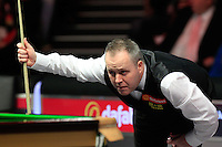 John Higgins lines up his next shot during the Dafabet Masters Q/F 4 match between John Higgins and Stuart Bingham at Alexandra Palace, London, England on 15 January 2016. Photo by Liam Smith / PRiME Media Images