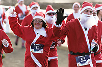 Pictured: Runners in Santa Claus fancy dress take part in this year's run in Aberavon, Wales, UK. Saturday 16 December 2017<br /> Re: 500 people have taken part in Run4All Santa 5km Run on Aberavon Promenade near Port Talbot, Wales, UK.