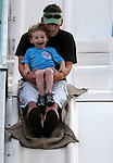 Nathan Scott, 3, of Windsor Locks, enjoys a ride on a gaint slide with his dad Michael Scott, during the Windsor Locks Fire Department annual carnival, Thursday, July 7, 2011, at Veterans Memorial Park on Southwest Ave. in Windsor Locks. The carnival continues Friday and Saturday evenings  with fire works Friday night at 9:30 and the annual fire department parade at 6:15 Saturday evening. (Jim Michaud/Journal Inquirer)