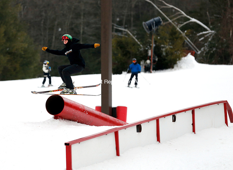 New Hartford, CT- 08 January 2016-010816CM02-  Eric Lugli of New Hartford, skis off a railing at Ski Sundown in New Hartford on Friday.  With the colder temperatures, ski resorts have been able to make snow for winter enthusiasts allowing them to participate in skiing and snowboarding.    Christopher Massa Republican-American