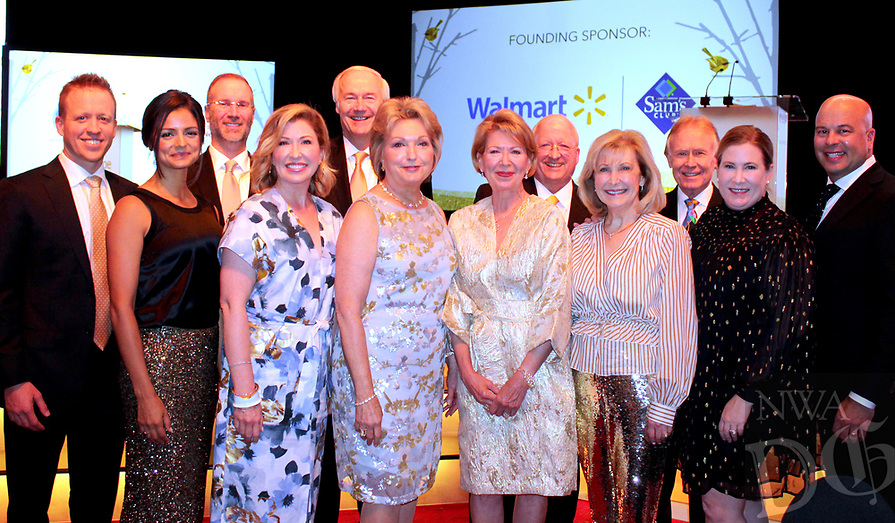NWA Democrat-Gazette/CARIN SCHOPPMEYER Charles and Samantha George (from left), Patrick and Julie Swope, Gov. Asa Hutchinson and wife Susan, Robin and Gary George, Cathy and David Evans and Linden and Brandon Seims help support Arkansas Children's Northwest.