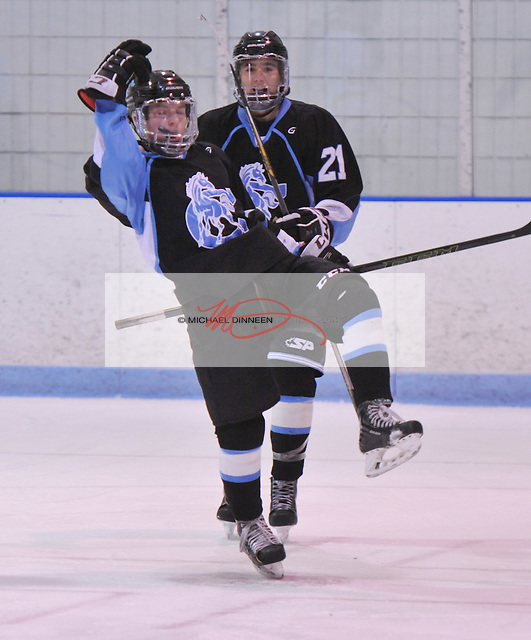 Chugiak's Andrew Beckett celebrates his first-period goal along with teammate Zachary Krajnik Thursday night.  Photo for the Star by Michael Dinneen