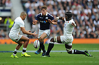 Huw Jones of Scotland chips between Jonathan Joseph and Maro Itoje of England during the RBS 6 Nations match between England and Scotland at Twickenham Stadium on Saturday 11th March 2017 (Photo by Rob Munro/Stewart Communications)