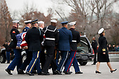 The flag-draped casket of former President George H.W. Bush is carried by a joint services military honor guard from the U.S. Capitol and loaded into a hearse, Wednesday, Dec. 5, 2018, in Washington. <br /> Credit: Shawn Thew / Pool via CNP
