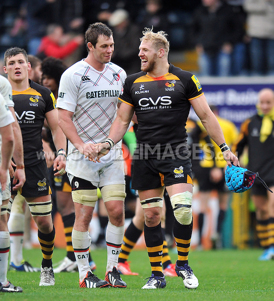 Louis Deacon and James Haskell shake hands after the final whistle. Aviva Premiership match, between London Wasps and Leicester Tigers on October 27, 2013 at Adams Park in High Wycombe, England. Photo by: Patrick Khachfe / JMP