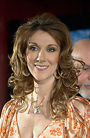 April 03, 2002, Montreal, Quebec, Canada; <br /> <br /> Singer Celine Dion talk about her new ballad-heavy album, A New Day Has Come after her two-year break,  during a press conference, with Rene Angelil, her husband and manager, April 03, 2002, in Montreal, Canada.<br /> <br /> Her new album is at the number one in 18 countries<br /> <br /> Her husband Rene Angelil finds himself fending off a civil suit alleging assault and sexual battery, that apparently happened two years ago in Las Vegas.