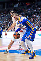 Real Madrid's Gustavo Ayón and Khimki Moscow's Paul Davis during Euroleague match at Barclaycard Center in Madrid. April 07, 2016. (ALTERPHOTOS/Borja B.Hojas) /NortePhoto