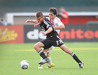DC United midfielder Perry Kitchen shields the ball against AFC Ajax midfielder Nicolas Lodeiro (15)    AFC Ajax defeated DC United 2-1 during an International Friendly at RFK Stadium Sunday May 22, 2011.