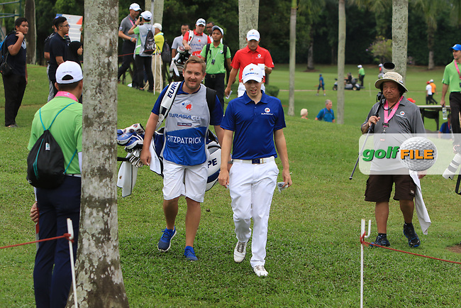 Matthew Fitzpatrick (Europe) walking to the 2nd tee during the Singles Matches of the Eurasia Cup at Glenmarie Golf and Country Club on the Sunday 14th January 2018.<br /> Picture:  Thos Caffrey / www.golffile.ie