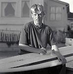 Surfer waxing surf board