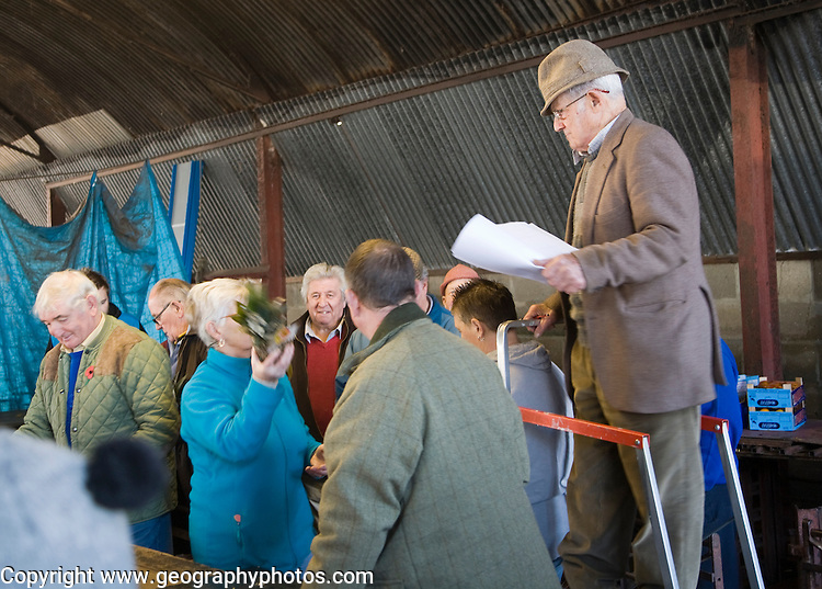 Auctioneer selling vegetable products at a country market, Abbots auctions, Campsea Ashe, Suffolk, England