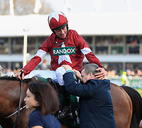 14h April 2018, Aintree Racecourse, Liverpool, England; The 2018 Grand National horse racing festival sponsored by Randox Health, day 3;  Davy Russell is joined by trainer Gordon Elliott in celebration after winning the Grand National on Tiger Roll