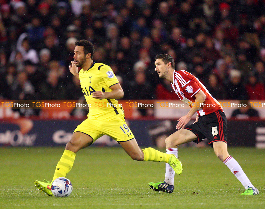 Chris Basham of Sheffield United and Mousa Dembele of Tottenham Hotspur - Sheffield United vs Tottenham Hotspur - Capital One Cup Semi Final action at the Brammell Lane Stadium on 28/01/2015 - MANDATORY CREDIT: Dave Simpson/TGSPHOTO - Self billing applies where appropriate - 0845 094 6026 - contact@tgsphoto.co.uk - NO UNPAID USE